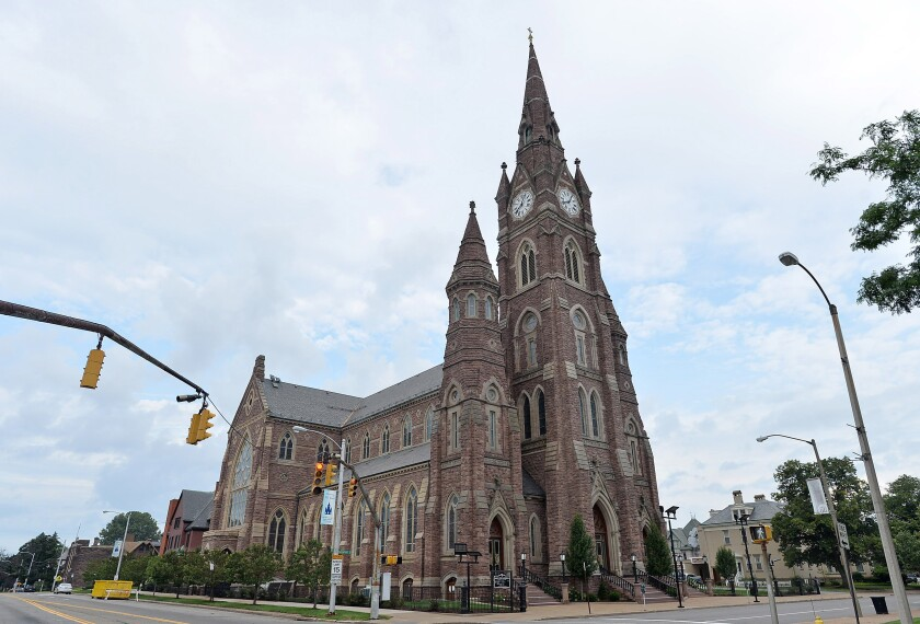 This Aug. 8, 2018 photo shows St. Peter Cathedral in Erie, Pa., the home parish for the Catholic Diocese of Erie. In mid-March 2020, the diocese closed its churches as the coronavirus spread, limiting its access to weekly donors, and applied for funds from the Paycheck Protection Program. It also decided to withhold payments from its victim-compensation program, saying its bank had decreased a line of credit. (Christopher Millette/Erie Times-News via AP)
