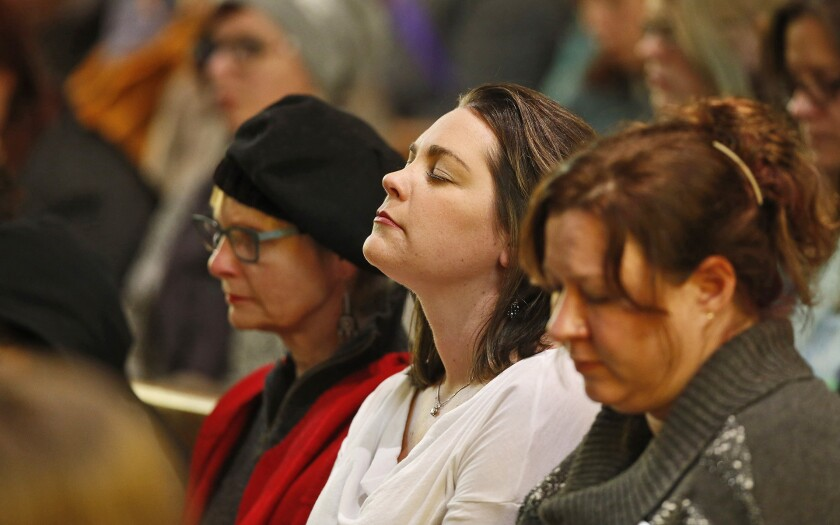 Mourners attend a vigil at All Souls Unitarian Universalist Church on Nov. 28, 2015, for the victims of the shooting the day before at a nearby Planned Parenthood clinic in Colorado Springs, Colo.