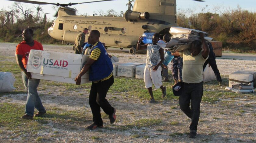 U.S. aid officials and service members deliver relief supplies to areas affected by Hurricane Matthew in Haiti in October 2016.