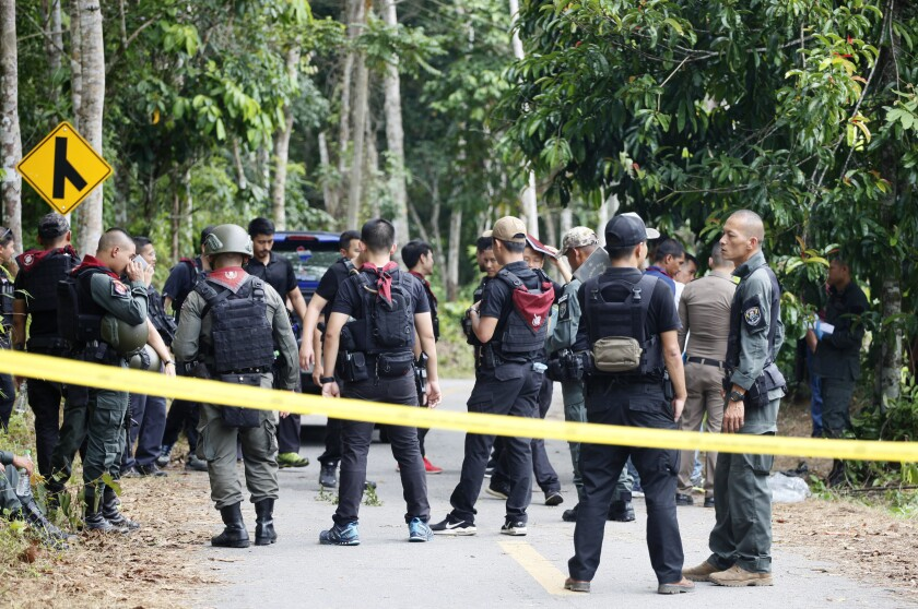 Police secure the road leading to a shooting scene in Yala province, Thailand, Wednesday, Nov. 6, 2019. Gunmen fired at security personnel at checkpoints in Thailand's insurgency-wracked south, killing 15 volunteer officers and wounding five others, police said Wednesday. (AP Photo/Sumeth Panpetch)