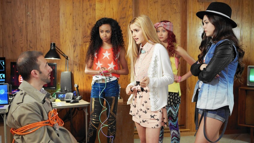 """This photo provided by Netflix shows actresses Genneya Walton, from left, Victoria Vida, Ysa Penarejo, and Mika Abdalla, in a scene from """"Project Mc2."""" The series about four clever schoolgirls recruited to join a spy organization will be released Aug. 7, 2015, on Netflix. (Netflix via AP)"""