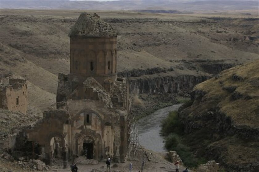 FILE - In this  Sept. 11, 2008 file photo, the Church of Tigran Honents at Ani is seen in the Turkey-Armenia border province of Kars, Turkey. Turkey has launched a project to conserve an ancient cathedral and a church in what is seen as a gesture of reconciliation toward neighboring Armenia. (AP Ph