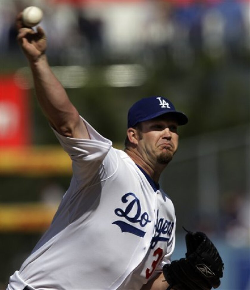 Los Angeles Dodgers pitcher Brad Penny throws a pitch during the sixth inning of the baseball game against the San Francisco Giants at Dodger Stadium in Los Angeles Monday, March 31, 2008. (AP Photo/Kevork Djansezian)