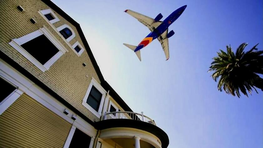 Many La Jollans say changes in flight paths have casued increases in airplane noise in several La Jolla neighborhoods. Pictured is a Southwest Airlines 737 passing over Bankers Hill en route to San Diego International Airport.