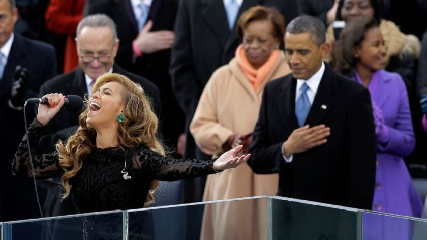 This Jan. 21, 2013 file photo shows President Barack Obama, right, as Beyonce sings the National Anthem at the ceremonial swearing-in at the U.S. Capitol during the 57th Presidential Inauguration in Washington.