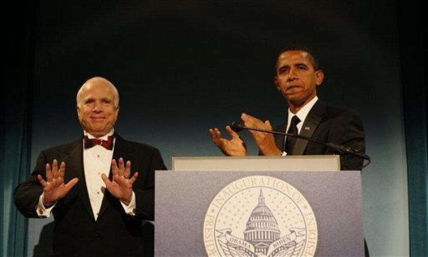 President-elect Barack Obama stands with Sen. John McCain, R-Ariz., at a dinner in Washington, Monday, Jan. 19, 2009. (AP Photo/Charles Dharapak)