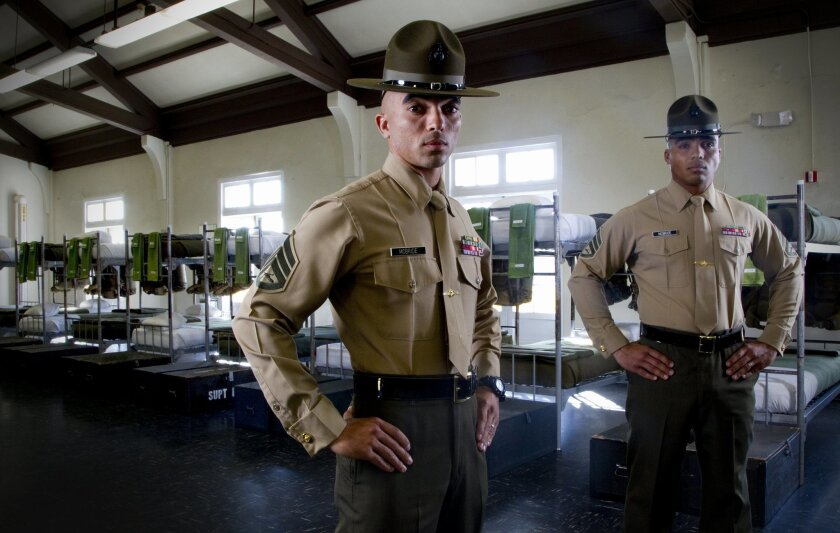 Marine Staff Sgts. Lukhma McBride (left) and Bakhit McBride stand in a squad bay used for Marines going through the Drill Instructor School at Marine Corps Recruit Depot. The drill instructors are brothers and speak three languages.