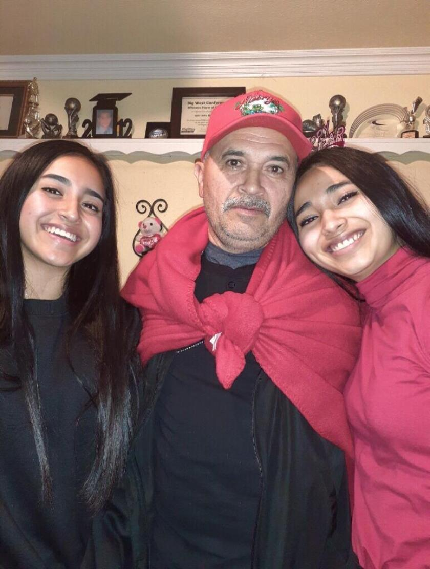 Héctor Echegoyén with two of his daughters, Laisha, left and the Harvard-bound Cielo, right.
