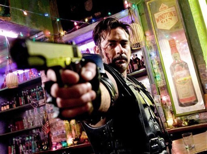 """In this image released by Warner Bros., Jeffrey Dean Morgan stars as The Comedian in a scene from the film, """"Watchmen."""" (AP Photo/Warner Bros. Clay Enos)"""