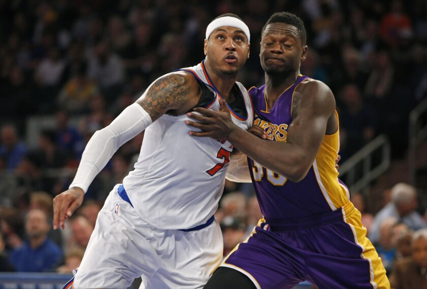 Knicks forward Carmelo Anthony and Lakers forward Julius Randle battle for rebounding position in a Nov. 8 game at New York's Madison Square Garden.