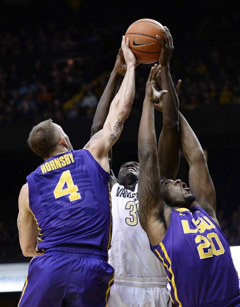 Vanderbilt forward James Siakam (35) pulls in a rebound against LSU guard Keith Hornsby (4) and forward Brian Bridgewater (20) during the first half of an NCAA college basketball game Saturday, Jan. 24, 2015, in Nashville, Tenn. (AP Photo/Mark Zaleski)
