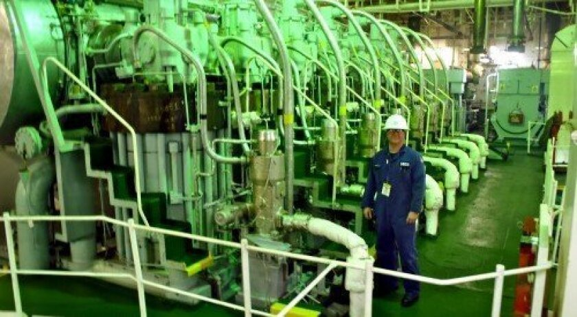 Chief Warrant Officer Gary L. Strebe inspects the main engine of an Oil Tanker. Photo courtesy of U.S. Coast Guard