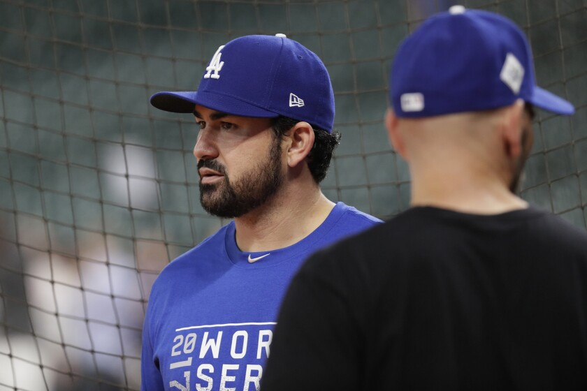 Adrian Gonzalez joined his Dodgers teammates before Game 3 of the World Series, but spent most of it apart from the team.