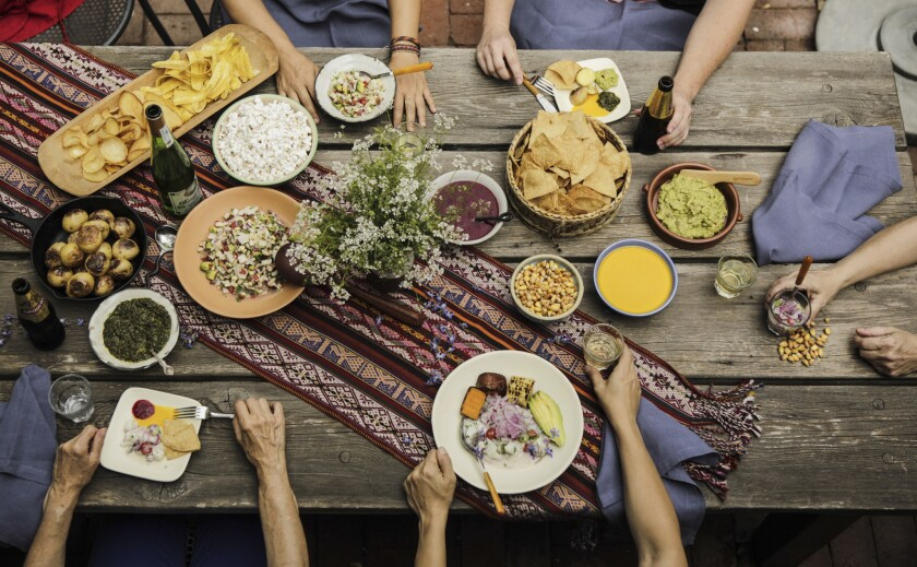 Peruvian and Ecuadorean ceviches and related salsas are set at the table.