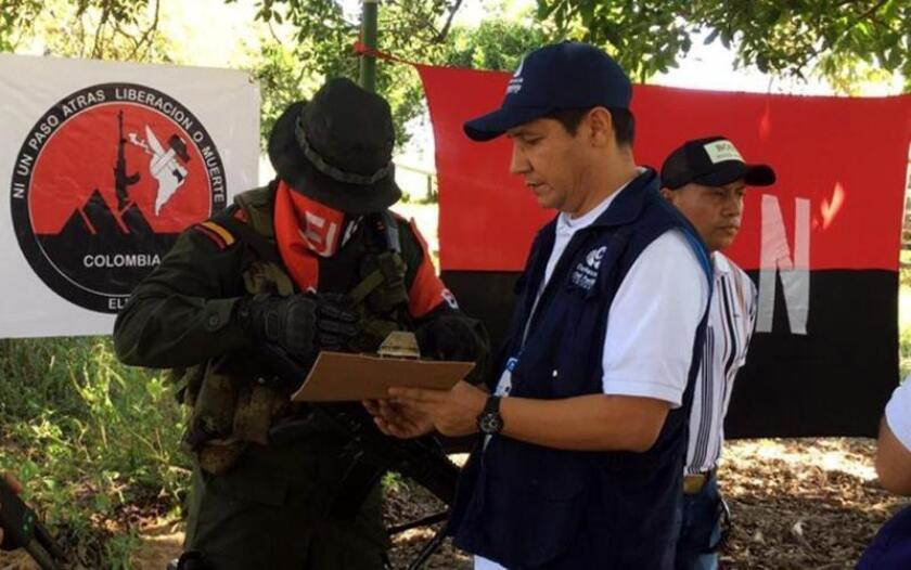 The Colombian National Ombud's Office provided this photo of the ELN rebel group releasing hostage Rafael Andres Riaño Ravelo (R) on Thursday, Dec. 27. EFE-EPA/Courtesy Defensor del Pueblo/EDITORIAL USE ONLY