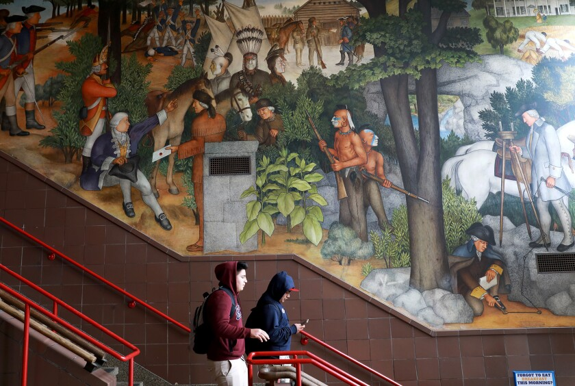 The San Francisco school district should not paint over a historic mural at George Washington High School despite some complaints over its content.