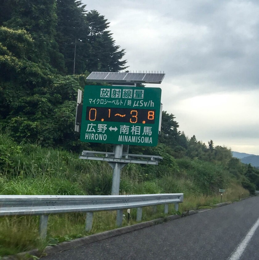 A roadside sign installed by the Japanese government south of the Fukushima Daiichi nuclear plant displays radiation readings.