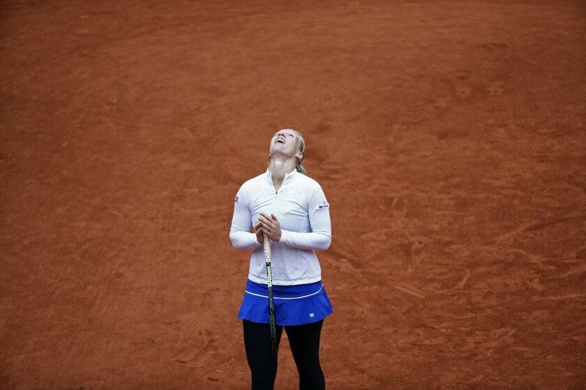 Netherlands' Kiki Bertens looks at the sky after missing a return in the semifinal match of the French Open tennis tournament against Serena Williams of the U.S. at the Roland Garros stadium in Paris, France, Friday, June 3, 2016. (AP Photo/Christophe Ena)