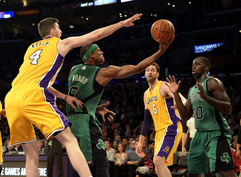 Lakers forward Ryan Kelly tries to block a reverse layup by Celtics point guard Rajon Rondo in the first half Friday night at Staples Center.