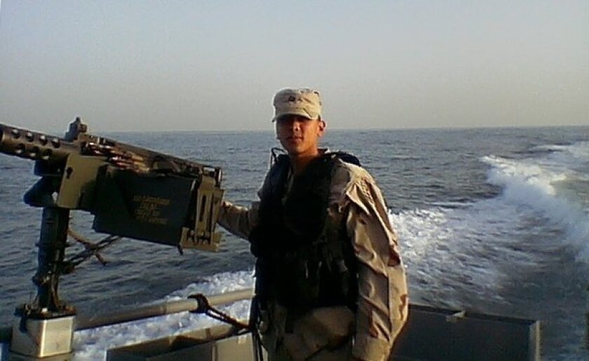 Ryan Panganiban, then a U.S. Army soldier, in 2004 off the coast of Iraq.