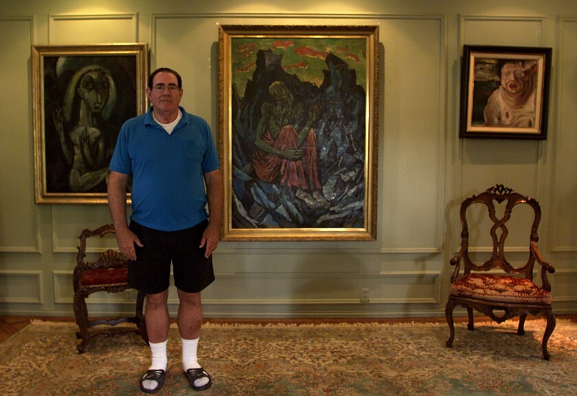 Robert Rifkind in 2008 stands with three of the German Expressionist works he collected.