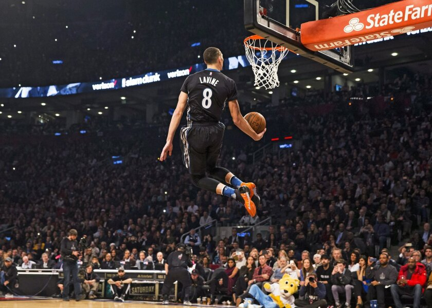 Minnesota Timberwolves Zach LaVine slam dunks the ball during the NBA all-star skills competition in Toronto on Saturday, Feb. 13, 2016. (Mark Blinch/The Canadian Press via AP) MANDATORY CREDIT