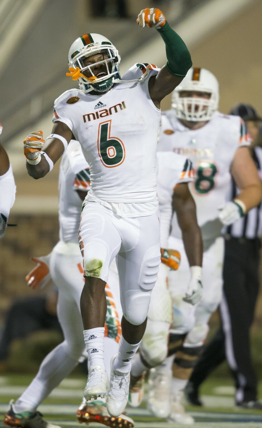 Miami's Jamal Carter celebrates a touchdown catch against Duke during the first half of an NCAA college football game in Durham, N.C., Saturday, Oct. 31, 2015. (AP Photo/Rob Brown)