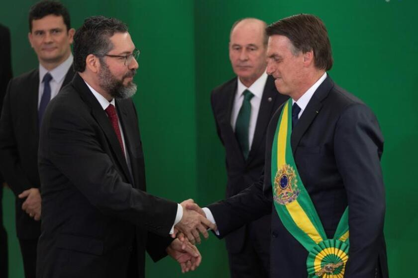Newly inaugurated Brazilian President Jair Bolsonaro (r) greets his foreign minister, Ernesto Araujo (l), after the inauguration ceremony at Planalto Palace in Brasilia on Jan. 1, 2019. EFE-EP/Joedson Alves