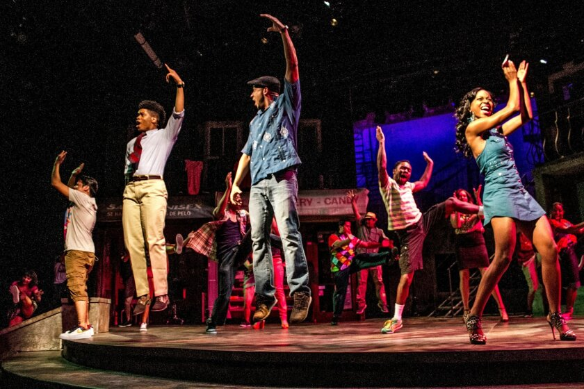 """Jai Rodriguez, center, and the cast of San Diego Repertory Theatre's """"In the Heights"""" at the Lyceum Theatre."""