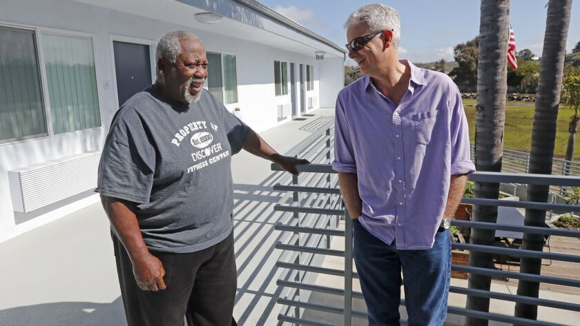 Donald Gates, 77, left, site manager and resident, shares a laugh with Larry Haynes, Mercy House exe
