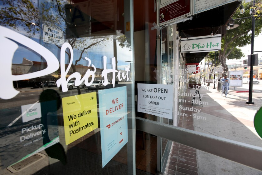 Restaurants like the Pho Hut on Brand Boulevard have switched to a to-go-only model after Los Angeles County health officials ordered restaurant dining rooms be shut down to help slow the spread of the novel coronavirus.