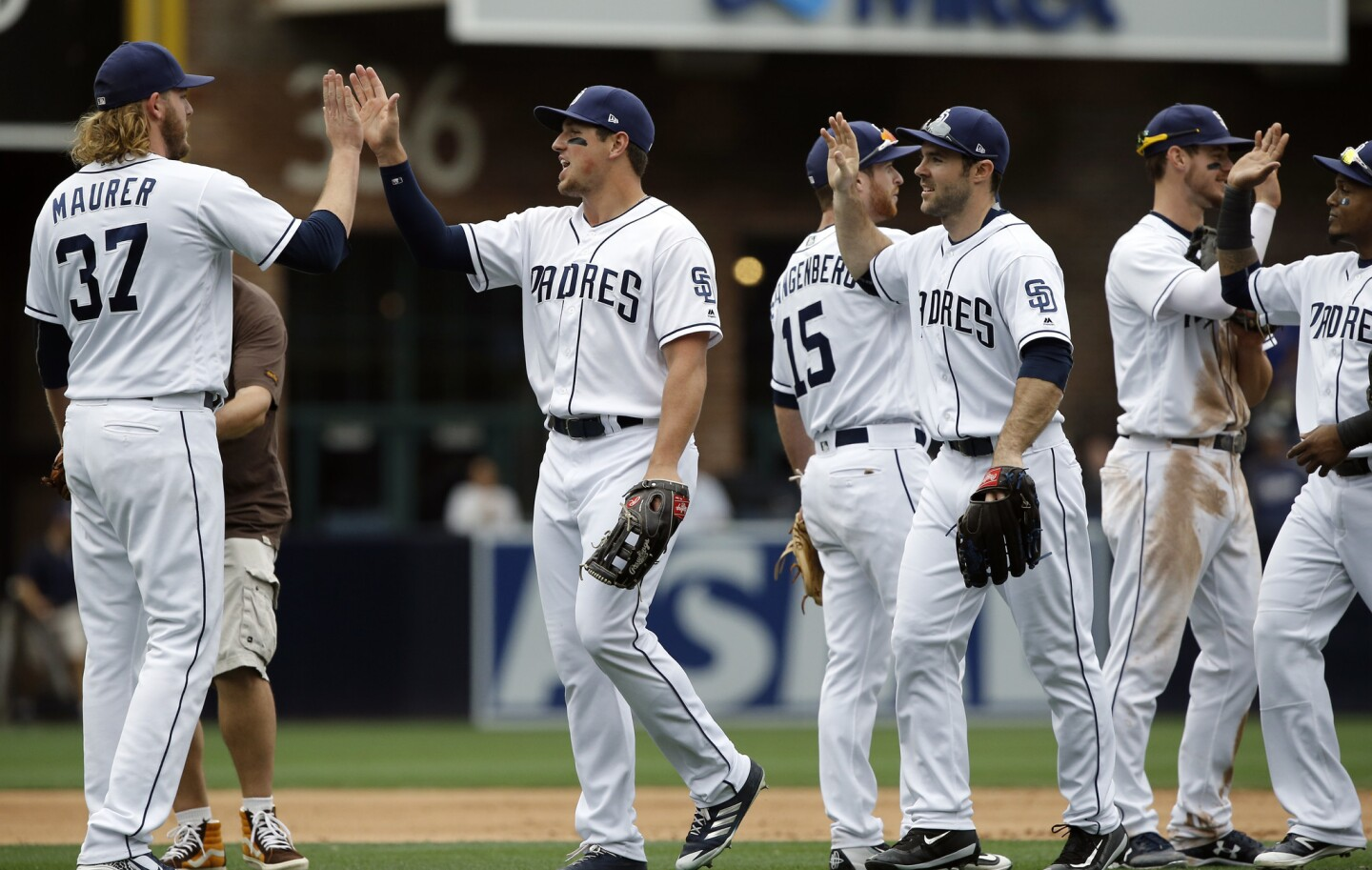 San Diego Padres players congratulate each other after the Padres defeated the Chicago Cubs 2-1 in a baseball game in San Diego, Wednesday, May 31, 2017. (AP Photo/Alex Gallardo)