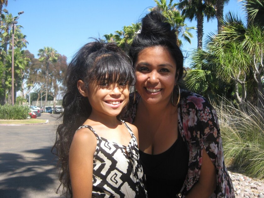 Gabriella 'Ella' Martinez, before she had 12 inches of hair cut and donated it to charity.