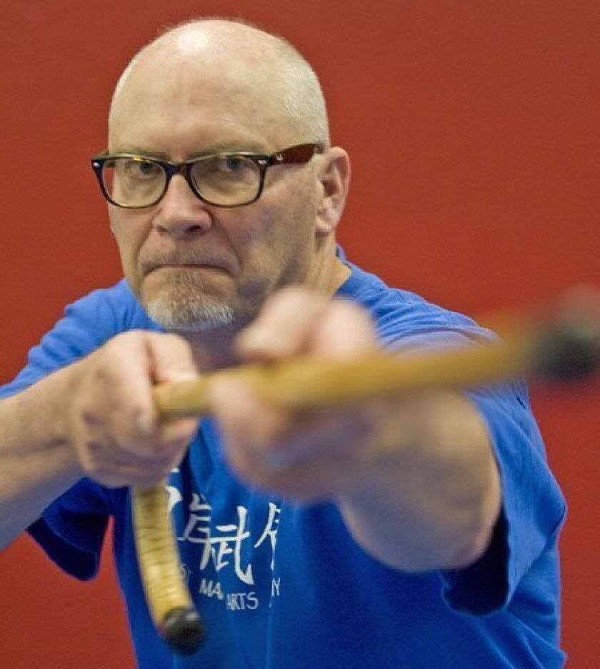"John Tipton took up ""cane fu fighting"" after a heart condition and back problems left him weakened. (Nelvin C. Cepeda / Union-Tribune)"