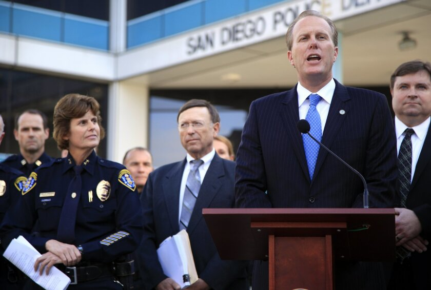 San Diego Mayor-elect Kevin Faulconer (R) introduces Assistant San Diego Police Chief Shelley Zimmerman (L), his choice to be the department's next chief, during a press conference Wednesday. The decision must be approved by the city council. City Attorney Jan Goldsmith is at center.