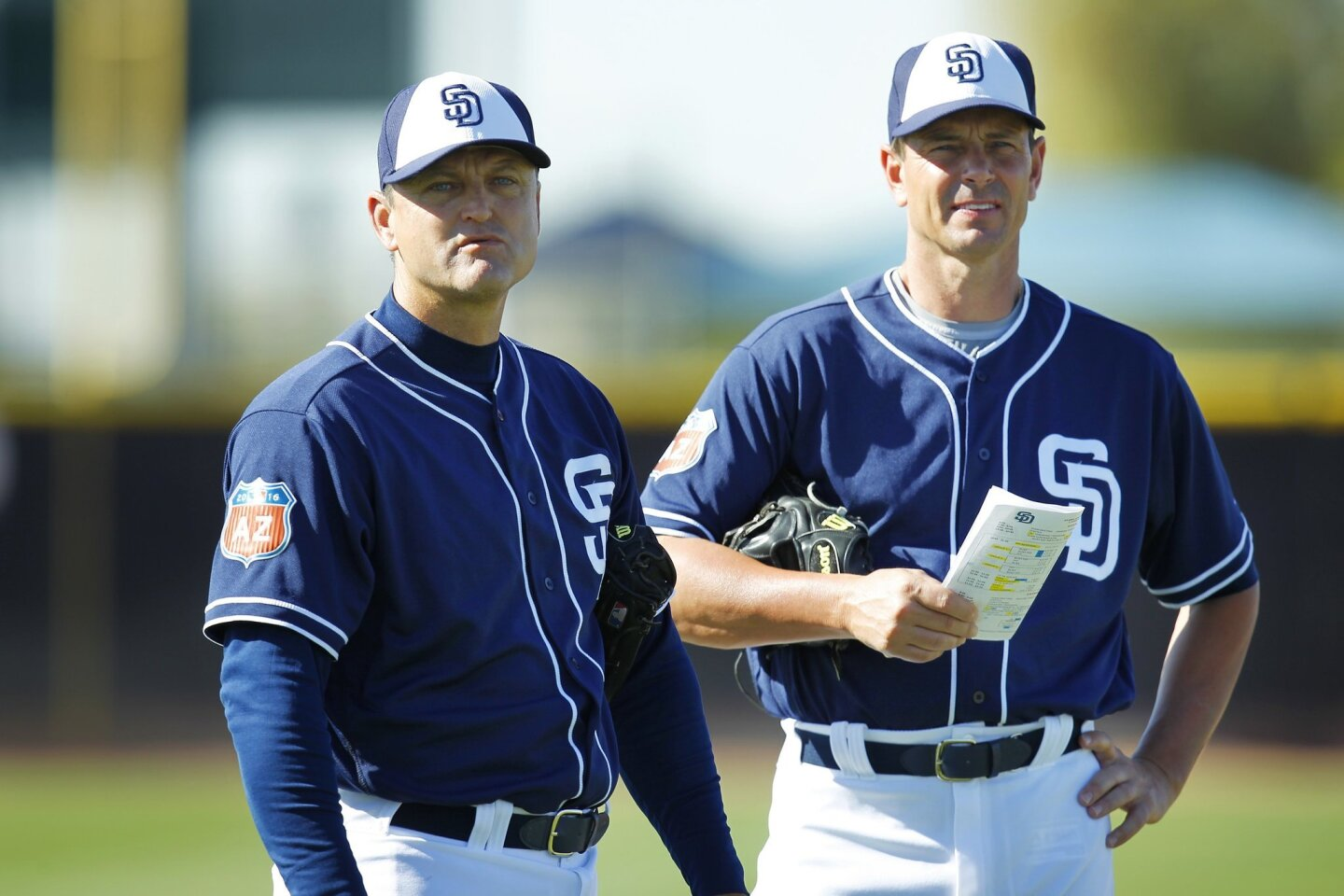 Former San Diego Padres pitchers Trevor Hoffman and Andy Ashby talk during a spring training practice.