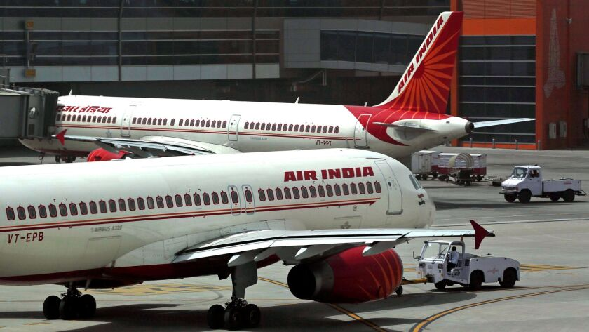 FILE - In this May 18, 2012, file photo, Air India planes are parked on the tarmac at the Terminal 3
