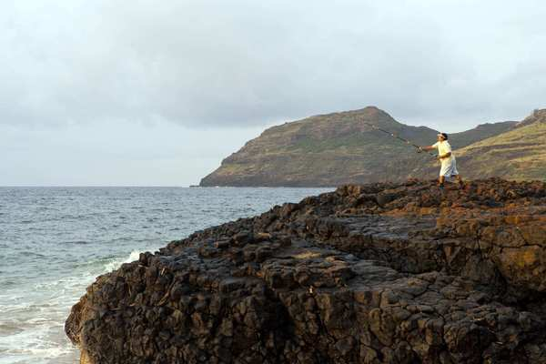 A man fishes off the Nawiliwili coast in Lihue.