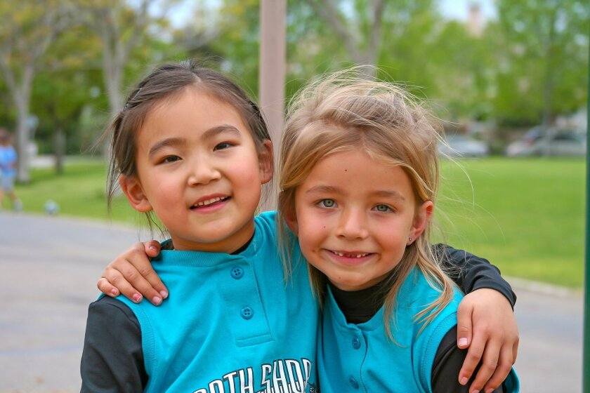 Nicole Kim and Madigan Wade in April 2008, their first year playing for North Shore in the 6U Division.