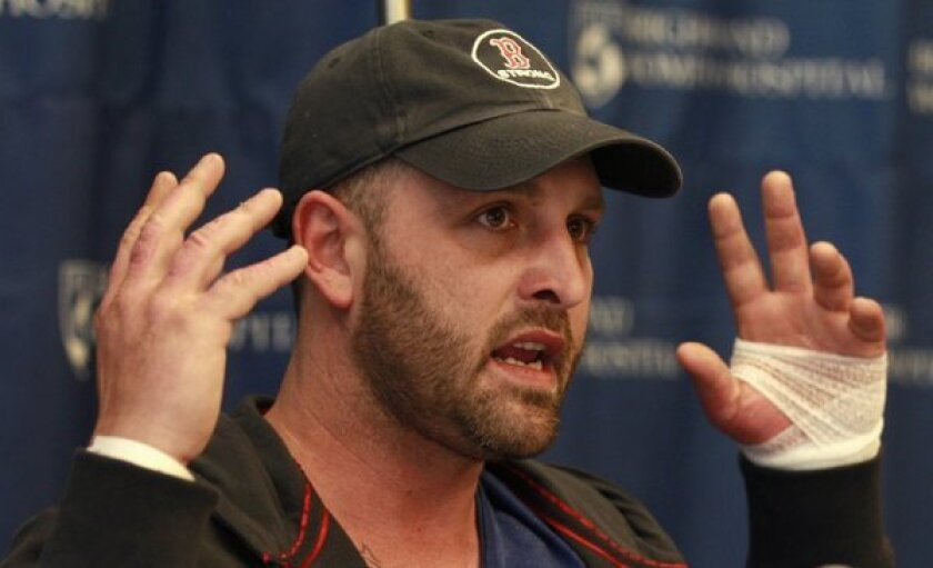 Boston Marathon explosion survivor Jarrod Clowery of Stoneham, Mass., describes the bombing scene near the finish line of the race during a news conference at Brigham and Women's Hospital in Boston.