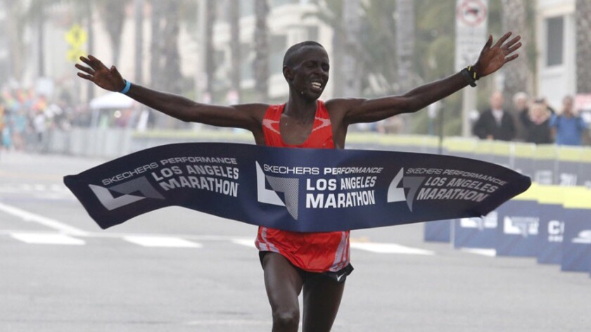 Elisha Barno crosses the finish line in Santa Monica to win the 32nd annual L.A. Marathon men's race.
