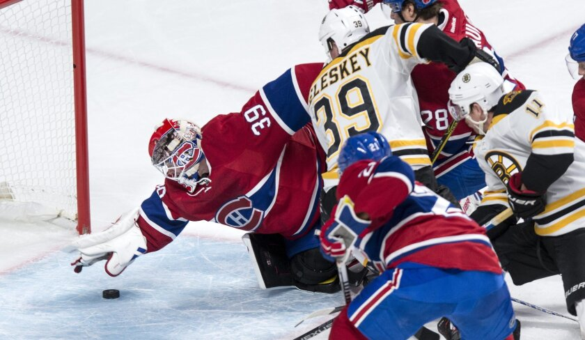Montreal Canadiens' goalie Mike Condon (39) snags a loose puck just in time as the Canadiens face the Boston Bruins during second period NHL hockey action, in Montreal, on Saturday, Nov. 7, 2015. (Paul Chiasson/The Canadian Press via AP)
