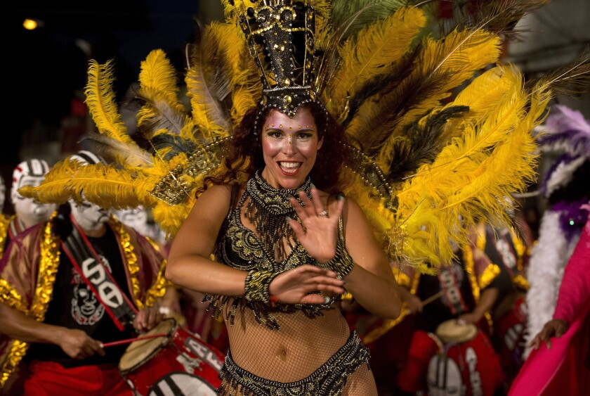 A dancer performs along a street in Montevideo's Sur neighborhood on the first night of the Llamadas (Calls) carnival parade. The Llamadas is Uruguay's biggest carnival parade, in which groups of dancers and drummers compete over the course of two nights.
