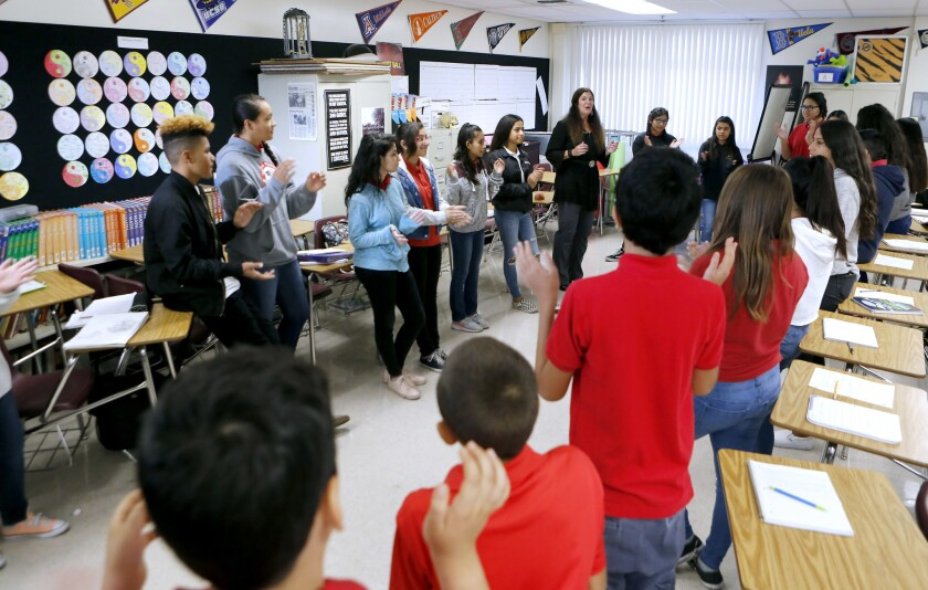 Roosevelt Middle School Pathway to College teacher Pam Zamaris uses restorative-justice practices to communicate and discipline students instead of issuing timeouts, office referrals and suspensions.