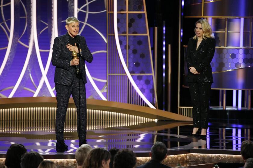 Ellen DeGeneres, left, accepts the Carol Burnett Award from presenter Kate McKinnon at the 77th Golden Globe Awards.