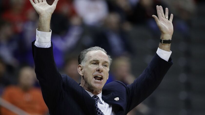 TCU coach Jamie Dixon talks to his players during the first half of an NCAA college basketball game