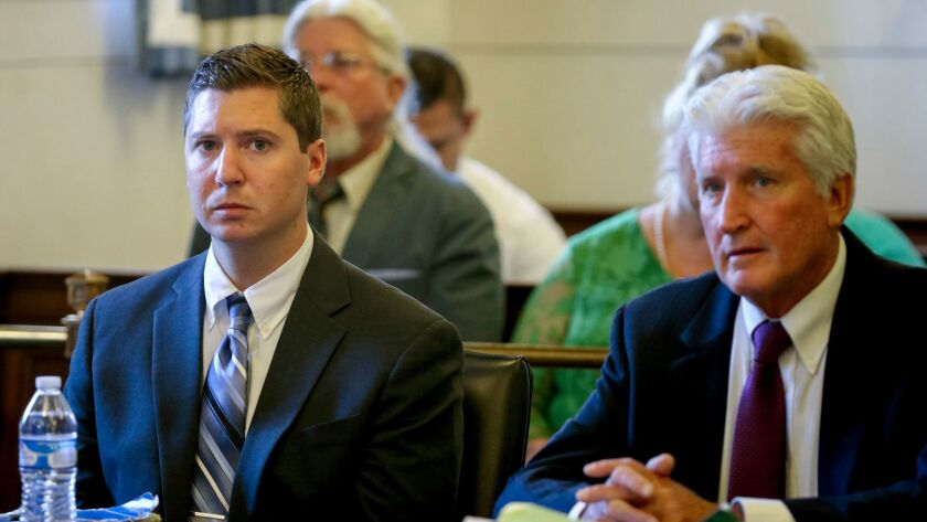 Ray Tensing, left, waits for his retrial to resume Thursday, June 15, 2017, at the Hamilton County C