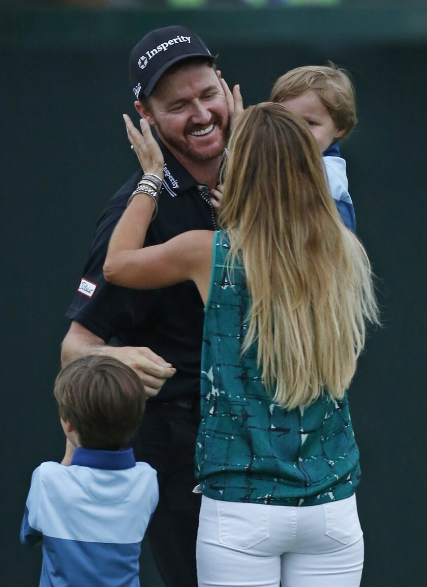 Jimmy Walker get a kiss from his wife Erin after winning the PGA Championship golf tournament at Baltusrol Golf Club in Springfield, N.J., Sunday, July 31, 2016. (AP Photo/Mike Groll)