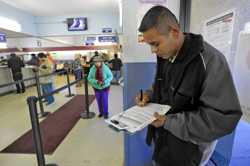 Eduardo Becerra gets his driver's permit at the DMV in Lincoln Park last year, after California began allowing immigrants in the U.S. illegally to obtain driver's licenses.