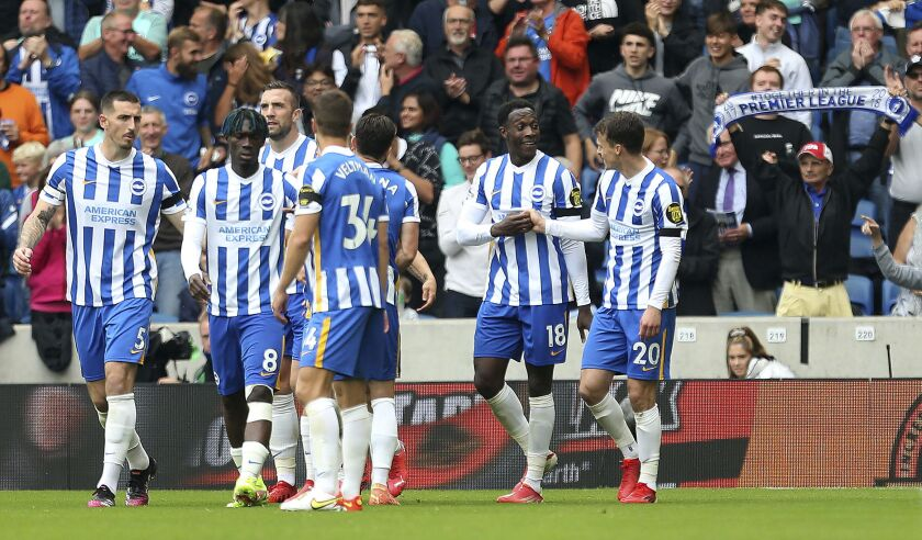 Brighton and Hove Albion's Danny Welbeck, second right, celebrates with Solly March after scoring during the English Premier League soccer match between Brighton & Hove Albion and Leicester City at the AMEX Stadium, Brighton, England, Sunday Sept. 19, 2021. (Steven Paston/PA via AP)